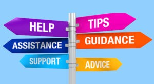 """The image shows six signs in different colours against a blue background. They say """"help"""", """"assistance"""", """"support"""", """"tips"""", """"guidance"""", and """"advice"""""""